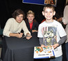Harry Styles, Niall Horan and a fan One Direction attend a signing for their new album 'Up All night' at Tesco Extra Maynooth in Kildare Kildare, Ireland