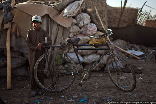 Child with bicycle in Kabul