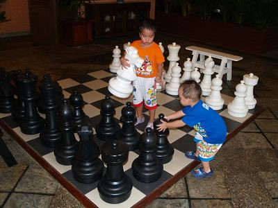 Boys on giant chess board