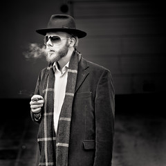 Stranger 05/100:  The Author (Explore #6) (PetterPhoto) Tags: street portrait man monochrome hat square nikon smoke cigar worldwide photowalk nikkor author kristiansand 50mmf14g 100strangers corneliusjakhelln d300s petterphoto