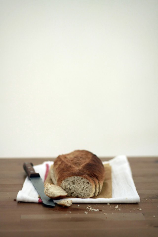 bread with knife and kitchen towel