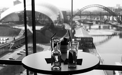 Drinking in the view (Wilamoyo) Tags: city bridge panorama window glass table blackwhite centre baltic tyne slug the newcastleupontynegateshead