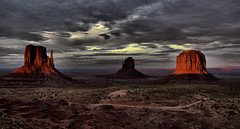 Monument Valley Sunset (Paul in Leeds) Tags: park camera travel sunset red sky panorama orange usa holiday west color colour slr monument colors weather rock clouds contrast digital america dead utah us sand scenery colorado rocks glow colours view desert state cloudy native dusk spires quality sony united ngc wide scenic shades full national american valley frame strata vista states clint geography geology navajo alpha dslr distance tones wispy 900 distant cumulous a900