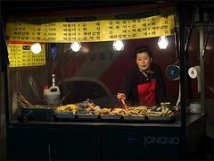 La Vie c'est du Cinéma (Christian Lagat) Tags: street food woman night lights femme stall korea spot rue nuit streetfood nourriture lumières 서울 corée 한국 séoul étal nikkor50mmf18d nikond90 cuisinederue lifeiscinema restaurationderue laviecestducinéma