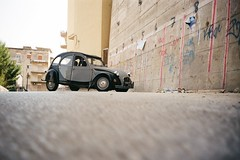... (icomewhenieatcaponata) Tags: camera italy color film car wall analog 35mm vintage toy concrete lomo lca lomography kodak toycamera iso 200 2cv sicily plus cockroach agrigento ratseyeview peppopeppo puddicinu