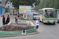 Pyongyang North Korea (Ray Cunningham) Tags: street bus girl traffic north korea pyongyang dprk coreadelnorte 平壤 평양 корейскаянароднодемократическаяреспублика northkoreanphotography raycunninghamnorthkoreanphotography dprkphotography koreainépidemokratikusköztársaság