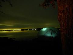 A tent, a tree, a lake. (Wojciechh) Tags: ocean road travel bridge camping camp sun house mountain beach home rain bicycle fog swimming fire freedom major us long desert awesome homeless cities sunny grand canyon days trail stealth miles states inspirational cheap touring