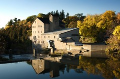 Mill reflection (Mark Heine Photos) Tags: blue trees sky ontario canada color colour reflection building fall mill leaves yellow stone river waterfall inn grand historic clear elora