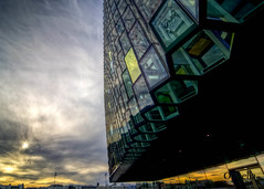 under the Harpa (by Ophelia photos) Tags: sun clouds iceland nikon reykjavk hdr harpa 2011 photomatix 5exp cs5 tokina1116 byopheliaphotos