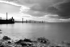 Crabbing (Anthony Owen-Jones) Tags: ocean uk longexposure sea blackandwhite bw cloud seascape black mountains beach monochrome wales clouds canon lens landscape eos rebel mono bay coast landscapes photo seaside fishing kiss europe long unitedkingdom jetty picture gimp minimal hills filter photograph nd kit postprocess minimalist bnw conwy t3i x5 rhosonsea colwynbay northwales rhos colwyn 600d takenwith 10stop nd110 canonefs1855mmf3556is rebelt3i kissx5