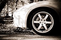 Wheel (Humphrey Hippo) Tags: uk england monochrome car wheel sepia 35mm nissan hampshire tokina gb newforest 350z fairlady zebedee ringwood nissan350z nissanfairlady tokinaatxm35prodx35mmf28macro