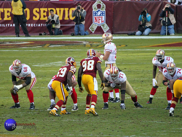 QB Alex Smith calls Time Out when he sees Brian Orakpo and London Fletcher starring him down.