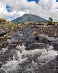 a place where nature is still firmly in control (SweetCaroline) Tags: water olympus gb brook zuiko indio legazpi albay mayonvolcano 1442mm e520 cloudcoveredmayon