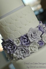 Closeup of handmade roses. (Christina's Dessertery) Tags: wedding roses white cake purple photoshoot lilac round pewter fondant gumpaste christinajohnson dragees creativecakedesigns ovalquilting
