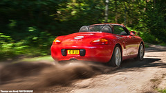 Boxster in Action  | EXPLORED | (Thomas van Rooij) Tags: charity red summer sun sunlight motion cars netherlands dutch car speed nijmegen photography movement sand nikon offroad action thomas stage rally nederland fast convertible s automotive run spyder business trail event exotic porsche burnout boxster panning supercar rolling gravel goed exotics supercars roadster cabriolet doel evenement 2011 tourrit rooij thomasvanrooij businessrallynijmegen