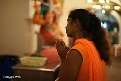 Her prayer will be answered. (Reggie Wan) Tags: asian singapore asia southeastasia candid praying hindutemple indiantemple srimariammantemple indiangirl reggiewan sonya850 sonyalpha850