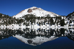 Lassen Peak Reflection (Ray Bouknight) Tags: california trees wallpaper lake snow reflection forest nationalpark october lassenvolcanicnationalpark shastacounty 2011 lassenpeak lakehelen