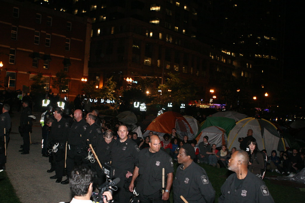 Occupy Boston - Police Raid © 2011 Paul Weiskel CC BY 2.0 DOOM! Magazine