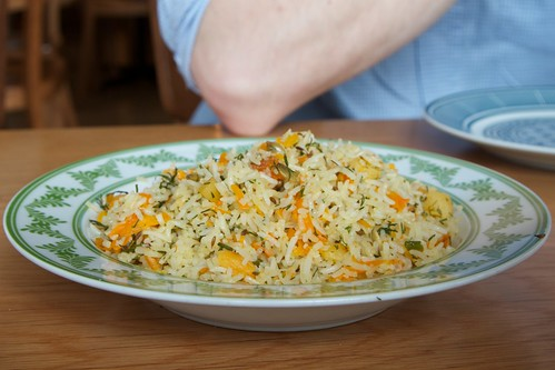 Rice pilaf with dill, apricot, carrot and toasted pumpkin seeds