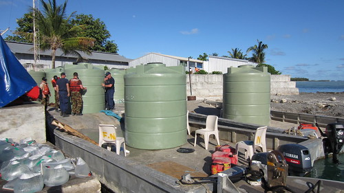 Preparing water tanks in Fakaofo.