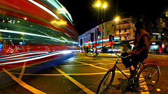 Cyclist Waiting at the Lights (Anatoleya) Tags: road light bus guy london bike night lens lumix evening long exposure cyclist cross traffic trails olympus panasonic kings pancake 20mm rd pentonville anatoleya epl3