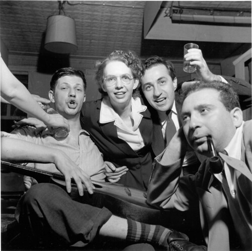 Sid Grossman, Jacqueline Judge, Jacob Deschin  (Photography critic for the New York Times),  and Arnold Eagle at a Photo Hunt party, 1947