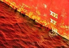 XVI (Karen_Chappell) Tags: ocean red orange canada abstract reflection water newfoundland boat rust ship harbour stjohns atlantic maritime nfld