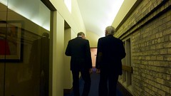 Tim & Tom walk down the hall to the forum