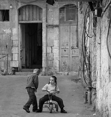 Easy Rider (ybiberman) Tags: street bw boys kids israel tricycle jerusalem tzitzit payot meashearom