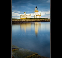 Waiting For Summer (cjdolfin) Tags: longexposure blue winter sea sun lighthouse white reflection water stone wall landscape scotland marine dolphin watching smooth scottish highland filter hightide rosemarkie blackisle morayfirth fortrose rossshire chanonrypoint cjdolfin