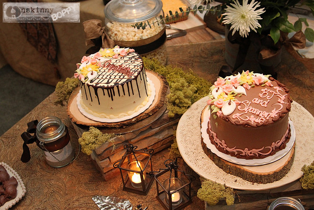 wedding cake with wood, rock, moss