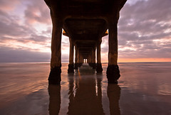 pillars (Andy Kennelly) Tags: ocean sea beach window wet clouds reflections point pier sand long exposure shadows pacific legs manhattan under columns column vanishing