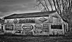 old brand garage (Gabe Oram Photography) Tags: old sky blackandwhite bw signs classic chevrolet metal clouds barn garage shell gas advertisement collection signage atlas cigars cocacola gasoline texaco hdr goodyear amoco motoroil goldbond tydol gassigns kingedwardcigars whiteflash motoroilsigns