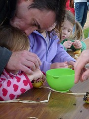 Dads happy to help make apple and seed birdfeeders