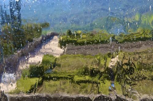Jardines de El Escorial a través de un viejo vidrio