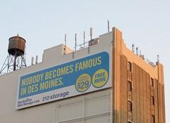 Nobody Becomes Famous In Des Moines (minnepixel) Tags: nyc newyorkcity light sunset sun eastvillage building skyline canon moving manhattan watertower ad storage advertisement gothamist gotham g11 secondavenue canonpowershotg11 212storage