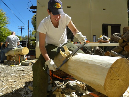 An HistoriCorps volunteer smooths a log to be used in the restoration of the Saguache Ranger Station on the Rio Grande National Forest. The restoration effort helped the U.S. Forest Service earn a 2011 National Preservation Honor Award from the National Trust for Historic Preservation.