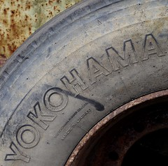 Inflated profits (Grooover) Tags: wheel word text rubber yokohama curve tyre grooover