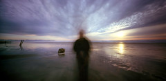 apparition. (manyfires) Tags: ocean longexposure sunset sea summer selfportrait film beach me self coast holga sand pacific shoreline pinhole spooky pacificocean pacificnorthwest apparition holga120wpc