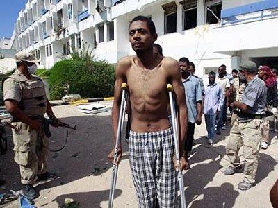 African prisoners being brutalized and tortured by NTC NATO-led rebels in Libya. A coalition of capitalist states coordinated by the US has waged war in the country since Feb. 2011.