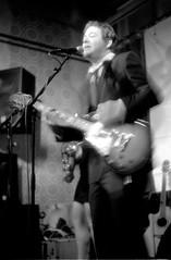 'Funky' Frans (Kjell_Doggen) Tags: music white black holland film me netherlands caf rock bar 35mm drums 50mm concert asahi pentax bass guitar gig shaved band nederland denhaag negative lucky muziek funk 100 reggae sax bas smc zwart wit thehague paard gitaar 7200 f17 shd negatief saxofoo