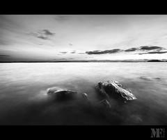 Water struck. (Mattias Fahlgren) Tags: sunset blackandwhite bw water monochrome nikon rocks sweden sigma karlstad 1020mm vnern skutberget d5000