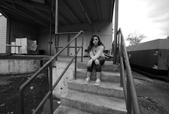 """""""We shouldn't be back here"""" (Mike Giannotti) Tags: portrait white black girl stairs dumpster photography photo dock pretty industrial sitting railing loading"""