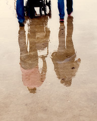 Reflection of Family in the Rain (E.L.A) Tags: road street family autumn people reflection love wet rain weather vertical standing turkey walking outdoors photography shoe togetherness holding couple europe day leg joy citylife istanbul romance simplicity flooring enjoyment onthemove selectivefocus partof colorimage unrecognizable abigfave lowsection november2011