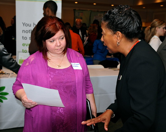 Attendee receiving one-on-one assistance from a recruiter at the 2013 Spring Career Fair.