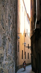 (bobbat) Tags: street light shadow italy woman bicycle florence alley italia tuscany firenze toscana itsnotacrop