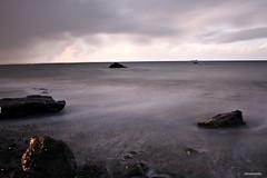 stones (JorunnSjofn) Tags: longexposure pink autumn sea sun beach water rock canon iceland waves stones reykjavik sunrays esjan 2011 jorunn