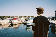 harbour (becomeacatalyst) Tags: boy sky ontario cute guy water boats outside harbour kingston portra yashica t4 160nc