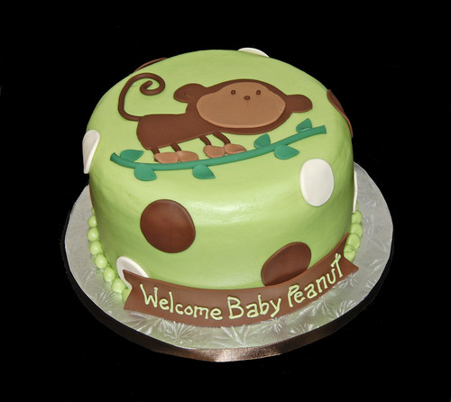 green and brown baby monkey on a branch baby shower cake
