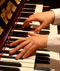 Hands playing organ